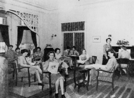 Group of servicewomen in the lounge room at Wairuna in Highgate Hill Brisbane in the 1940s
