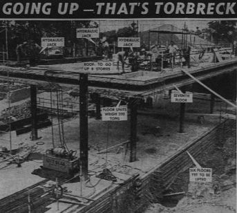An image of the lift slab construction of the garden block under way. (Courier-Mail 12th February 1959).