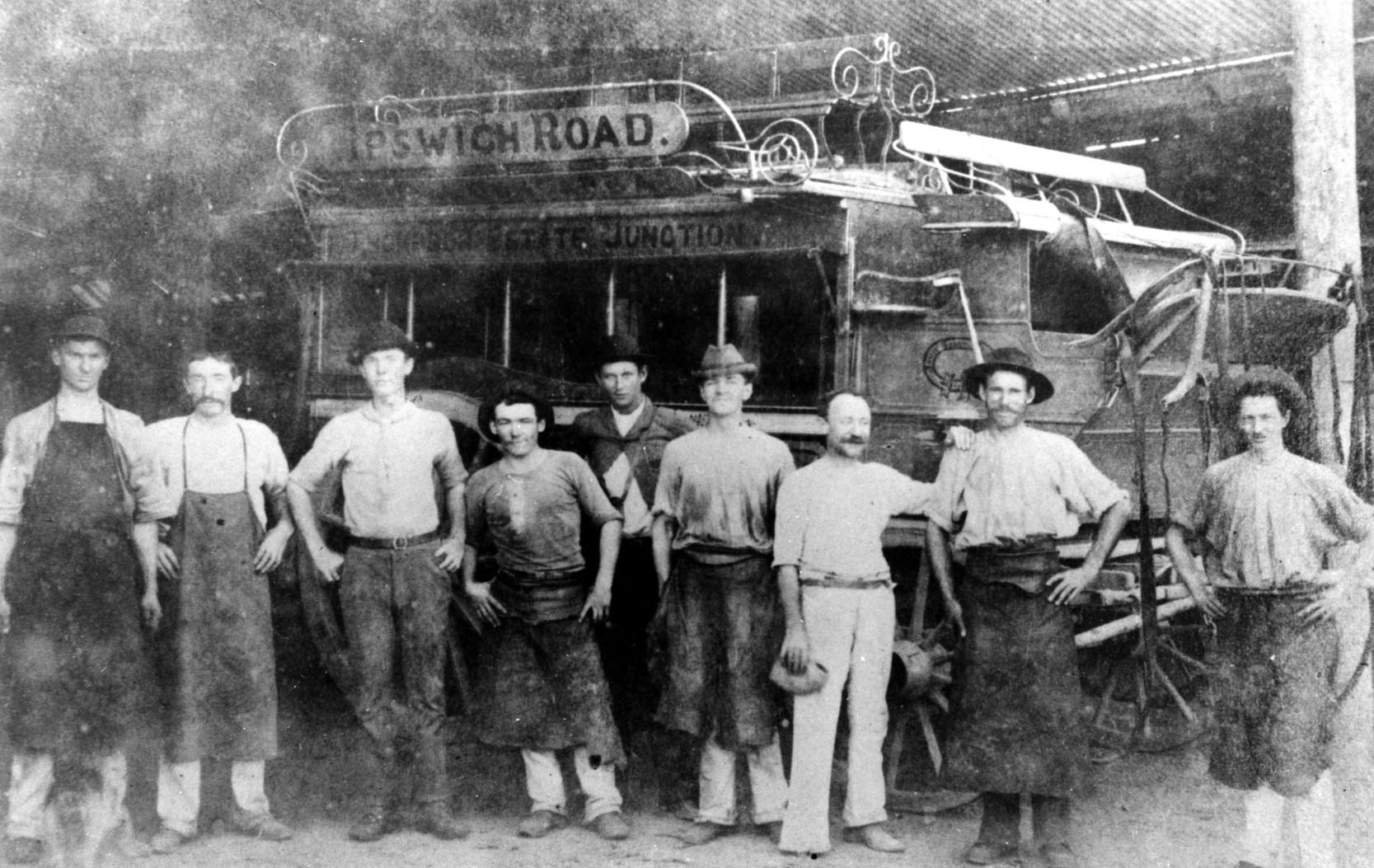 Workmen in front of a horsedrawn bus, in a transport depot, Brisbane, ca 1895 slq